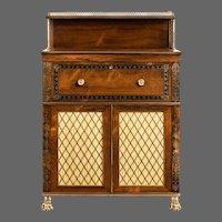 A Regency brass-inlaid rosewood secretaire