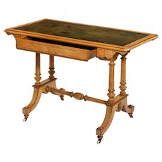 A Victorian Satinwood writing table, attributed to Holland and Sons