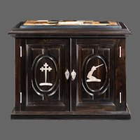 A superb early Victorian ebony collector's cabinet