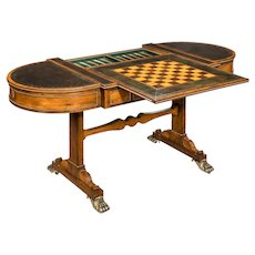 A Regency rosewood games table attributed to Gillows