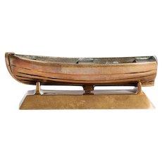 A bronze novelty desk tidy