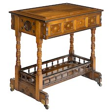 A walnut side table/jardinière by Gillows, probably after Augustus Pugin