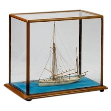 An alabaster model of a sailing yacht Jermaine