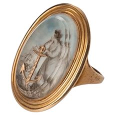 A George III gold ring depicting 'Hope'