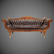 A Regency mahogany leather sofa