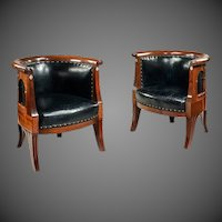 A pair of Danish Art nouveau mahogany and mother of pearl armchairs