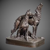 An patinated bronze group of two hounds by Mark Thomas