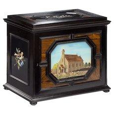 A fine quality ebony bijouterie table cabinet showing Cavalry Church, Stonington, Long Island