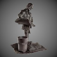 Meiji period bronze of a labourer