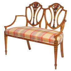 A late Victorian Sheraton revival painted satinwood two-seater settee
