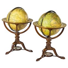 A pair of Carys 12 inch library table globes