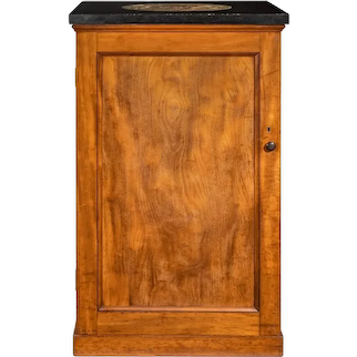 A Victorian mahogany collector's cabinet with a fossil marble top