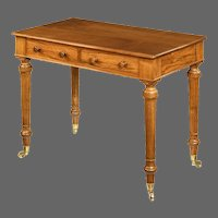 A mid-Victorian free-standing walnut writing table by Holland and Sons