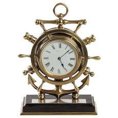 A brass ship's novelty clock presented to Captain Tynte F Hammill RN
