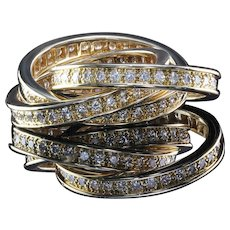 Diamond set rolling ring by Cartier