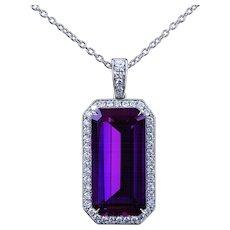 Emerald cut natural amethyst in a platinum/diamond pendant