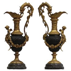A pair of Antique Patined Bronze Ewers