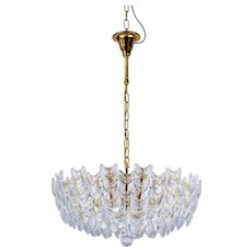 A gilt brass chandelier with glass. German, circa 1960s.