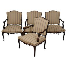 A suite of four Louis XV walnut fauteuils