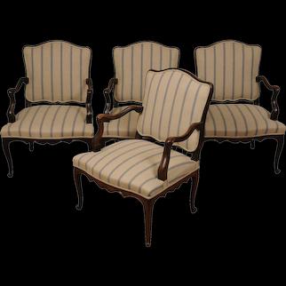 A suite of four Louis XV walnut fauteuils