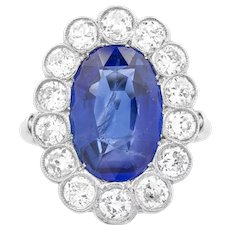 A Large Burma Sapphire And Diamond Cluster Ring