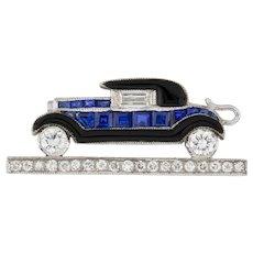 A Sapphire, Diamond And Enamel Car Brooch