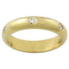 A Yellow Gold Diamond Wedding Ring