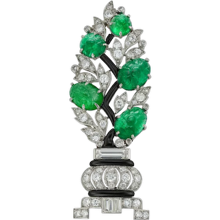 A French Art Deco Diamond And Carved Emerald Brooch