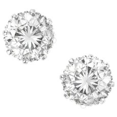 A Pair Of Round Brilliant-cut Diamond Stud Earrings