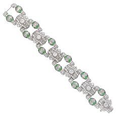 An Art Deco Emerald And Diamond Panel Bracelet