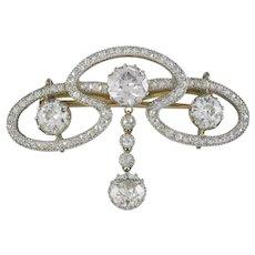 An Art Nouveau Diamond Scroll Brooch