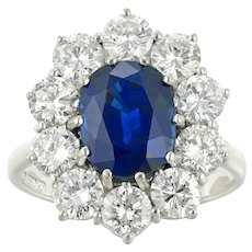 An Oval Sapphire And Diamond Cluster Ring