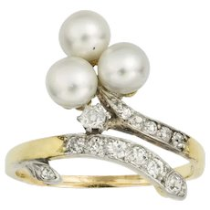 A Victorian Trefoil Pearl And Diamond Cross-over Ring