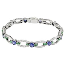 An Art Deco Sapphire, Emerald And Diamond Bracelet