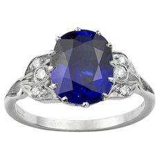 A Cushion-shape Sapphire And Diamond Ring