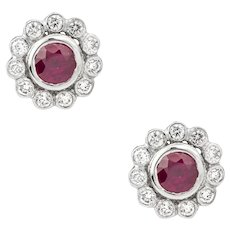 A Pair Of Ruby And Diamond Cluster Earrings