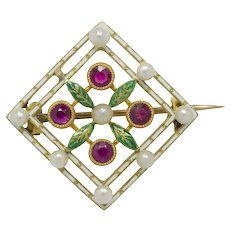 A Late Victorian Enamel Pearl And Ruby Brooch