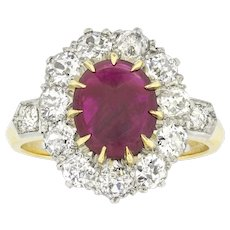 A Ruby Cabochon And Diamond Cluster Ring