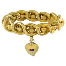 A Victorian Gold Twist Bracelet With Gold Locket
