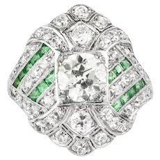 A Art Deco Diamond And Emerald Dress Ring