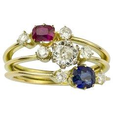A Ruby, Diamond And Sapphire Three Row Ring