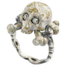 An Enamel And Diamond Skull Ring