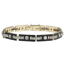An Art Deco Black Enamel And Diamond Bracelet