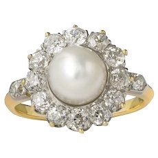 An Edwardian Natural Pearl And Diamond Cluster Ring