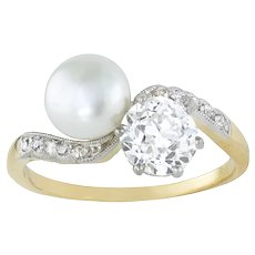 An Edwardian Natural Pearl And Diamond Cross Over Ring