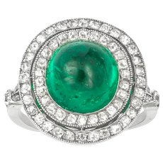 An Art Deco Cabochon Emerald And Diamond Cluster Ring