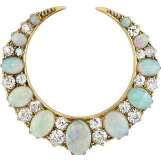 A Late Victorian Opal And Diamond Crescent Brooch