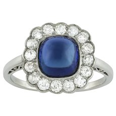 An Early 20th Century Sugarloaf Sapphire And Diamond Ring