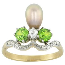 A Belle Epoque Natural Pearl, Garnet And Diamond Ring