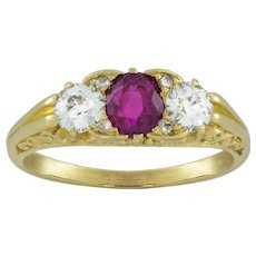 A Three Stone Carved Half Loop Ruby And Diamond Ring